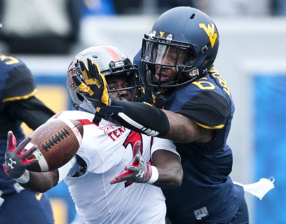 West Virginia safety Dravon Askew-Henry (6) defends Texas Tech wide receiver Jakeem Grant (11) on Saturday, Nov. 7, 2015, at Milan Puskar Stadium in Morgantown, W.Va. The pass was incomplete. WVU won 31-26.