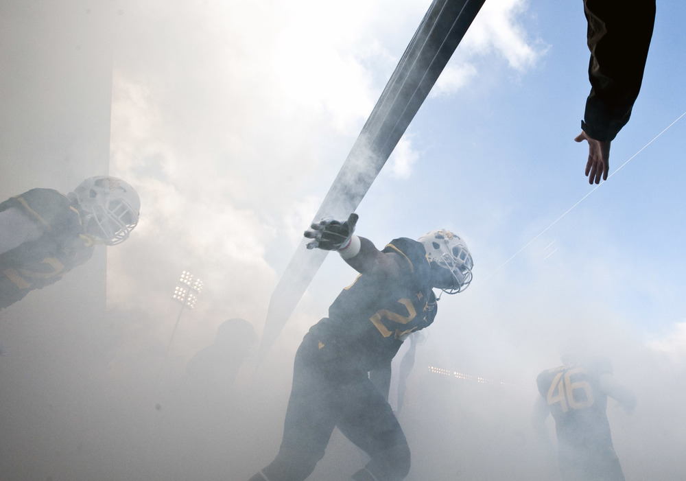 West Virginia safety Jeremy Tyler (24) runs onto the field before playing Texas on Saturday, Nov. 14, 2015, at Milan Puskar Stadium in Morgantown, W.Va. WVU won 38-20.