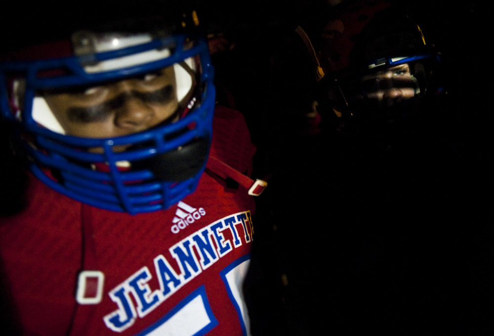Jeannette's Jimmy Malik, right, prepares to take the field against Chartiers-Houston during a WPIAL football game on Friday, Nov. 6, 2015 at Jeannette's McKee Stadium.