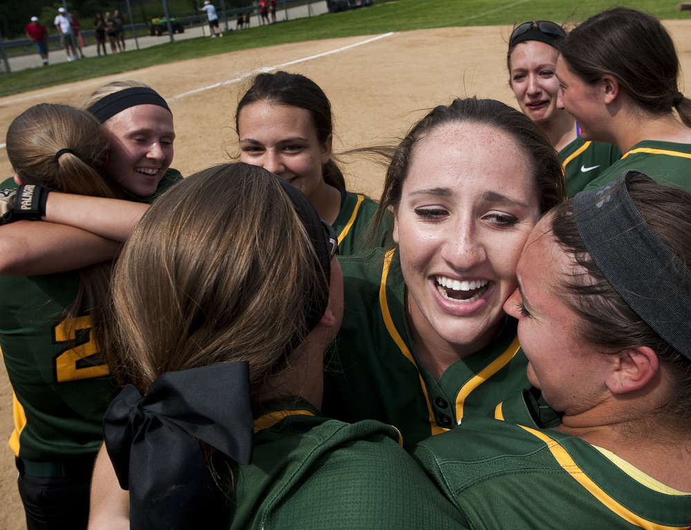Deer Lakes' Maria Taliani, center, hugs pitcher Tiffany Edwards, right, as they celebrate with teammates their win over Mohawk during the WPIAL Class AA softball championship on Thursday, May 28, 2015 at California University of Pennsylvania. Deer Lakes won 13-5.