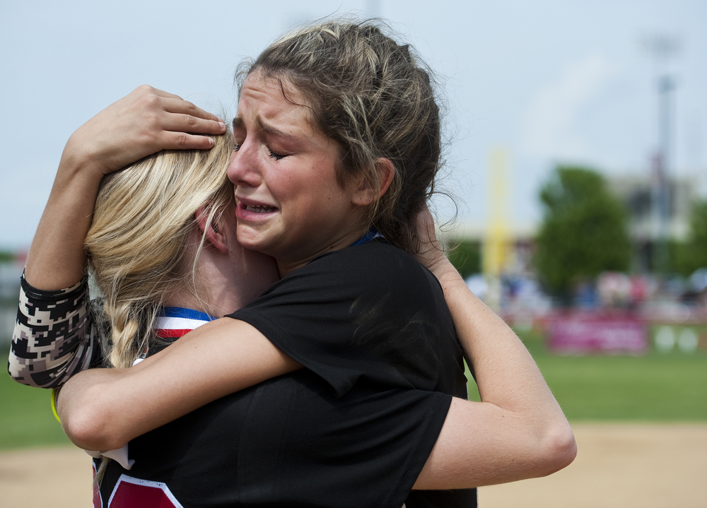 Mohawk's Samantha Carr cries as she embraces Christine Jones after their loss to Deer Lakes during the WPIAL Class AA softball championship on Thursday, May 28, 2015 at California University of Pennsylvania. Deer Lakes won 13-5.