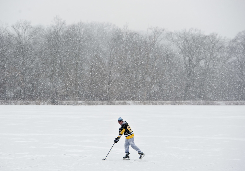 Connor Kok of Latrobe, a freshman student at Seton Hill University, plays hockey on a pond near St. Vincent College on Wednesday, Jan. 20, 2016. Kok's childhood idol was former Pittsburgh Penguin Jaromír Jágr.