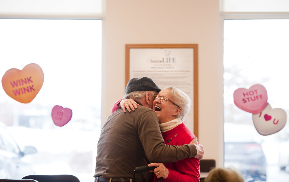 Esther Czekaj, 75 of Mt. Pleasant, receives a hug from Antonio Moffa, 91 of Jeannette, during a Valentine's dance at Senior LIFE in Greensburg on Monday, Feb. 15, 2016.