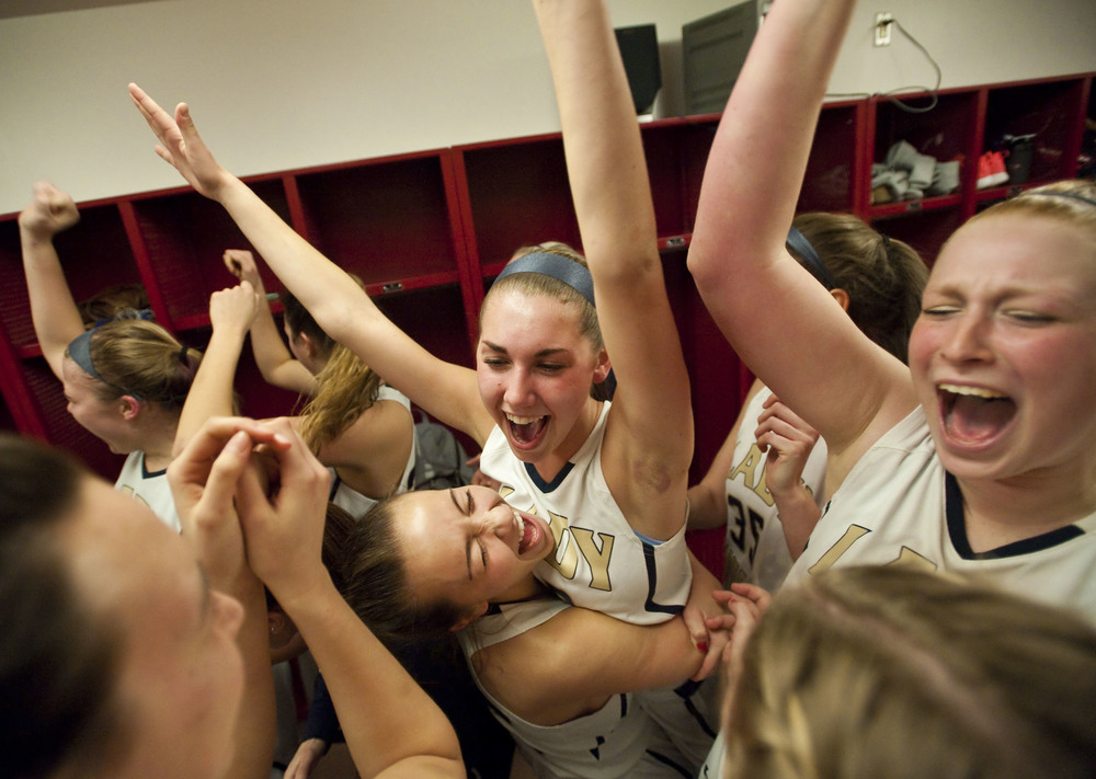 Norwin's Maura O'Donnell lifts Taylor Ingel as the team celebrates their win over Pine Richland during the WPIAL semifinal on Tuesday, Feb. 23, 2016 at Fox Chapel High School. Norwin won 59-30.