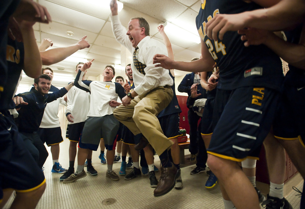 Mars Area assistant coach Scott Pfeiffer celebrates his team's win in the locker room over Bishop McDevitt during a PIAA Class AAA semifinal on Tuesday, March 15, 2016 at Altoona High School. Mars won 80-62.