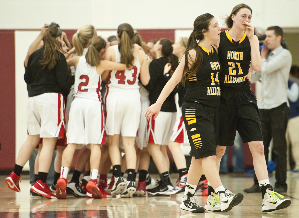 North Allegheny's Piper Morningstar (21) and North Allegheny's Rachel Martindale (14) walk off the court dejected as Cumberland Valley celebrates their win during a PIAA Class AAAA semifinal on Tuesday, March 15, 2016 at Altoona High School. Cumberland Valley won 43-42.