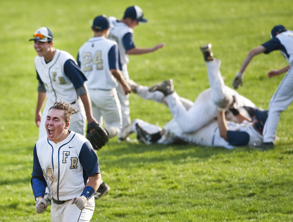 Franklin Regional's Alex Christie reacts as his teammates dog pile Bryce Halleck after Halleck's game-winning RBI after beating Gateway at Haymaker Park in Murrysville on Wednesday, April 27, 2016. Franklin Regional won 3-2 in 11 innings.