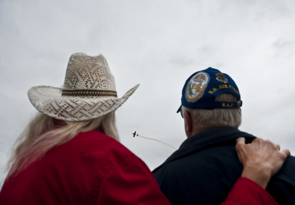 Irene Hummert embraces boyfriend an Air Force veteran Chuck Boal of Monroeville as they watch pilot Michael Wiskus at the Westmoreland County Shop 'n Save Airshow at Arnold Palmer Regional Airport on Saturday, May 21, 2016.