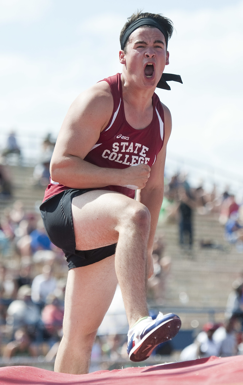 State College's Griffin Thompson reacts after his pole vault clear during the Class AAA PIAA track and field championships at Shippensburg University on Friday, May 27, 2016 in Shippensburg. Thompson finished in first place.