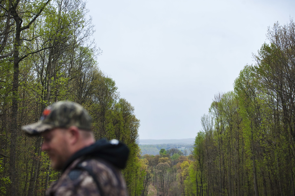 BAPS Bigfoot and Paranormal Society co-founder Shawn Dennis pauses at the top of a pipeline tree clearing during the 2016 Pennsylvania Bigfoot Camping Adventure at Benner's Meadow Run campground near Farmington on Friday, May 6. Experts say Bigfeet prefer hilly, wooded areas and pipeline clearings make their habitats easily accessible. The Farmington area has been known as a Bigfoot hotbed with numerous encounters reported by campers, hunters and locals.