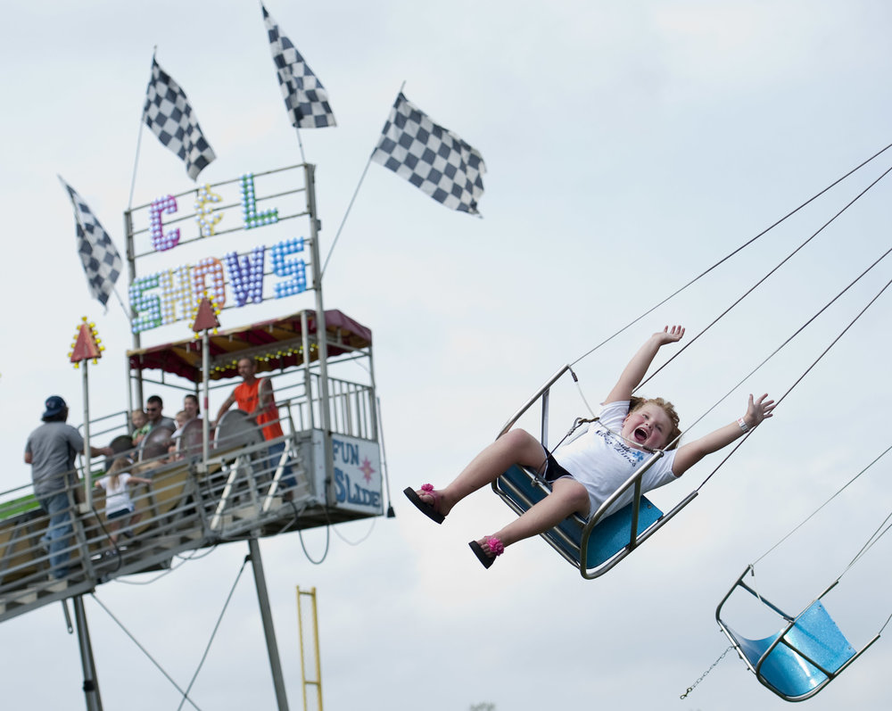 Lydia Grant, 6 of Penn Township, rides a swing during the Penn Township Fall Festival on Saturday, Sept. 17, 2016 at the Penn Township Municipal Park in Harrison City. The second phase of the $500,000 improvements to the 63-acre park was the highlight of the festival.