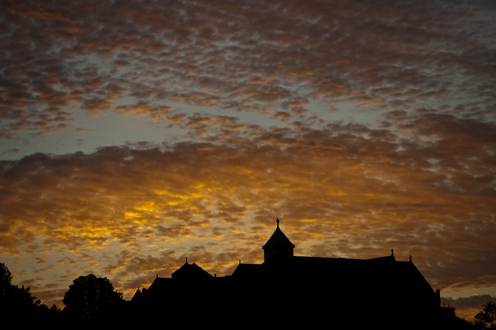 The sun sets behind Seton Hill University in Greensburg on Saturday, Sept. 3, 2016.