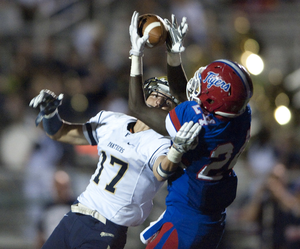 Franklin Regional's Vinny Pysnik defends against McKeesport's Layton Jordan during an attempted reception on Friday, Sept. 2, 2016 in McKeesport. McKeesport won 14-7.