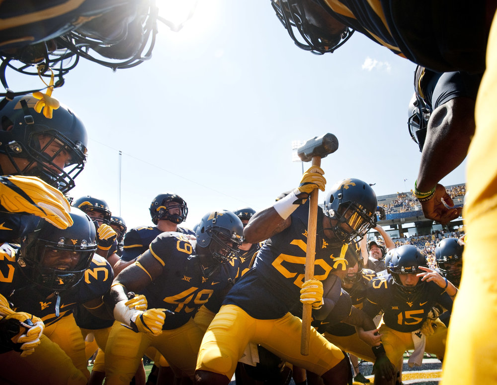 West Virginia safety Jarrod Harper #22 pumps up his team before taking the field against Youngstown State on Saturday, Sept. 10, 2016 at Milan Puskar Stadium in Morgantown, W.Va. WVU won 38-21.