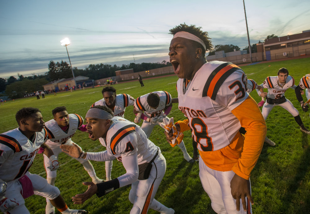 Clairton's Lamont Wade and Clairton's Noah Hamlin amp up their team before playing Jeannette on Friday, Oct. 28, 2016 at Jeannette's McKee Stadium. Clairton beat Jeannette 32-13.