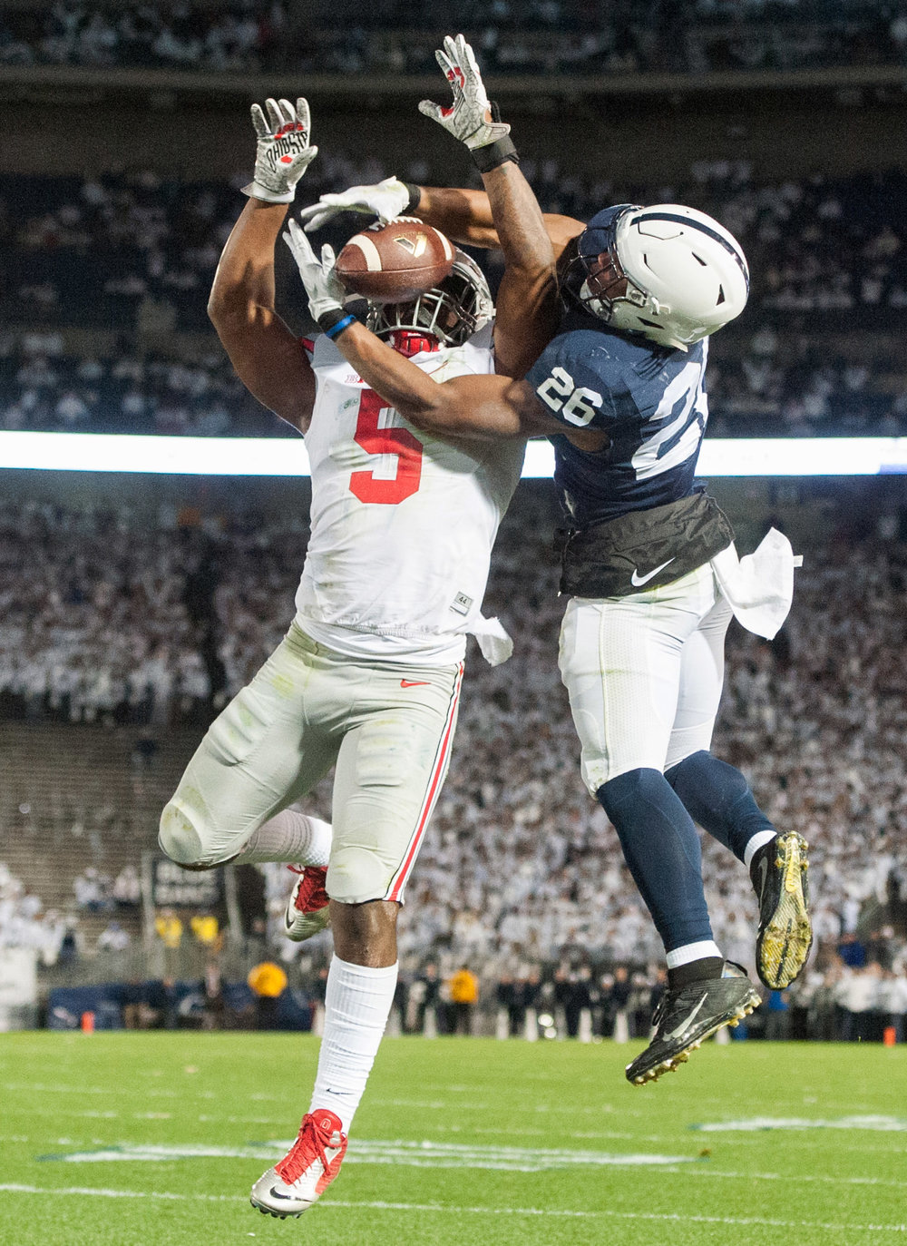 Penn State running back Saquon Barkley can't pull in a touchdown pass while pressured by Ohio State linebacker Raekwon McMillan during a college football game Saturday, Oct. 22, 2016, at Beaver Stadium in University Park.  Penn State beat Ohio State 24-21.