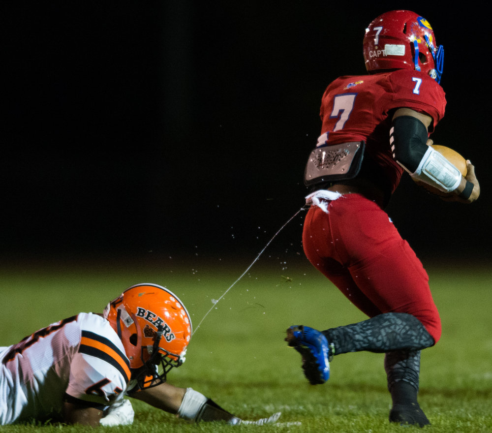 Clairton's Daiqwaan Lovett hangs onto a string of Jeannette's Kareem Hall on Friday, Oct. 28, 2016 at Jeannette's McKee Stadium. Clairton beat Jeannette 32-13.