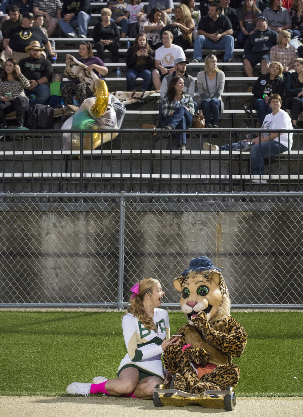 Sophomore Belle Vernon cheerleader Sydney Baciak laughs with her friend and mascot Vienna Bertram during the game against Thomas Jefferson on Friday, Oct. 13, 2017 at Belle Vernon Area High School. (Steph Chambers/Post-Gazette)