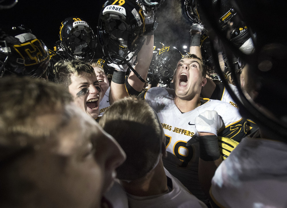 Thomas Jefferson's Devin Danielson celebrates with his teammates after beating Belle Vernon 27-0 during the WPIAL semifinal on Friday, Nov. 10, 2017 at Baldwin High School. (Steph Chambers/Post-Gazette)