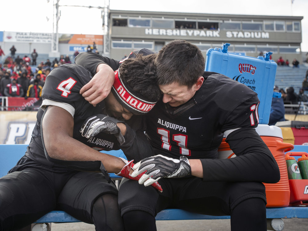 Aliquippa's Avante McKenzie and Aliquippa's Eli Kosanovich react on the bench together as time winds down to their victory over Middletown, 35-0, during the PIAA Class 3A football championship on Saturday, Dec. 8, 2018, in Hershey. (Steph Chambers/Post-Gazette)