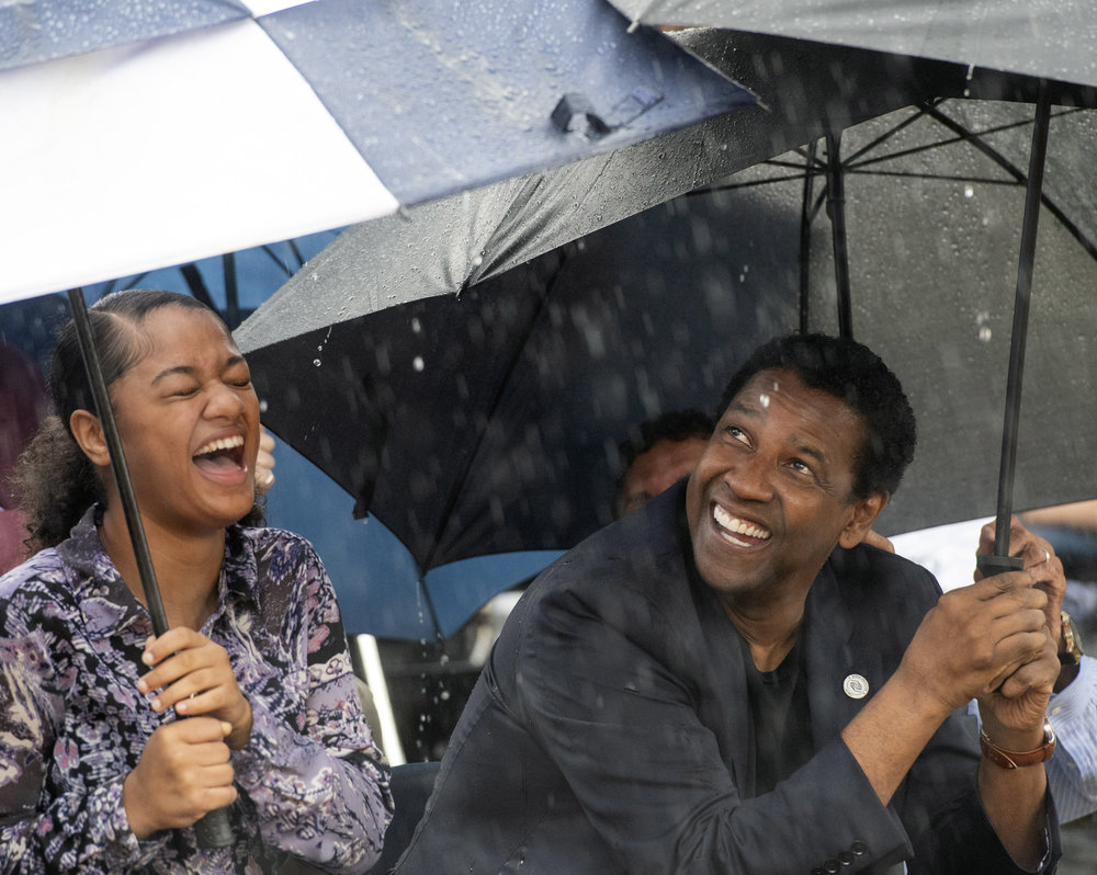 "Jamaica Johnson, an 11th-grader at Pittsburgh CAPA, and Denzel Washington share a moment during a ""ground blessing"" at the August Wilson House on Wednesday,when the actor announced $5 million in support of the projects at the playwright's childhood home. Jamaica performed a monologue from ""King Hedley II"" at the ceremony. (Steph Chambers/Post-Gazette)"