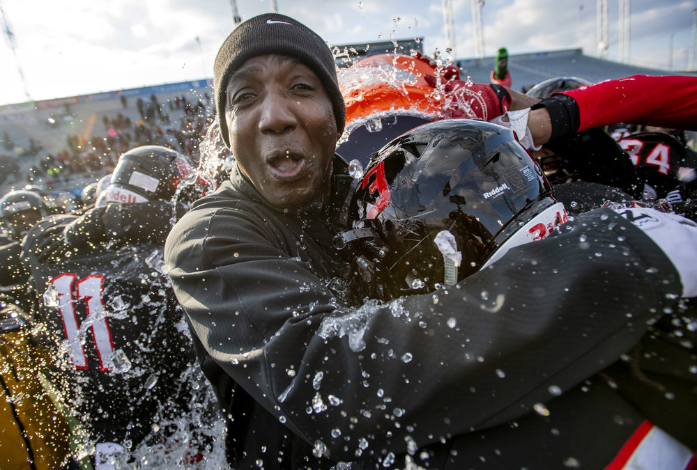 Aliquippa head coach Mike Warfield is doused with water after beating Middletown, 35-0, during the PIAA Class 3A football championship on Saturday, Dec. 8, 2018, in Hershey. (Steph Chambers/Post-Gazette)