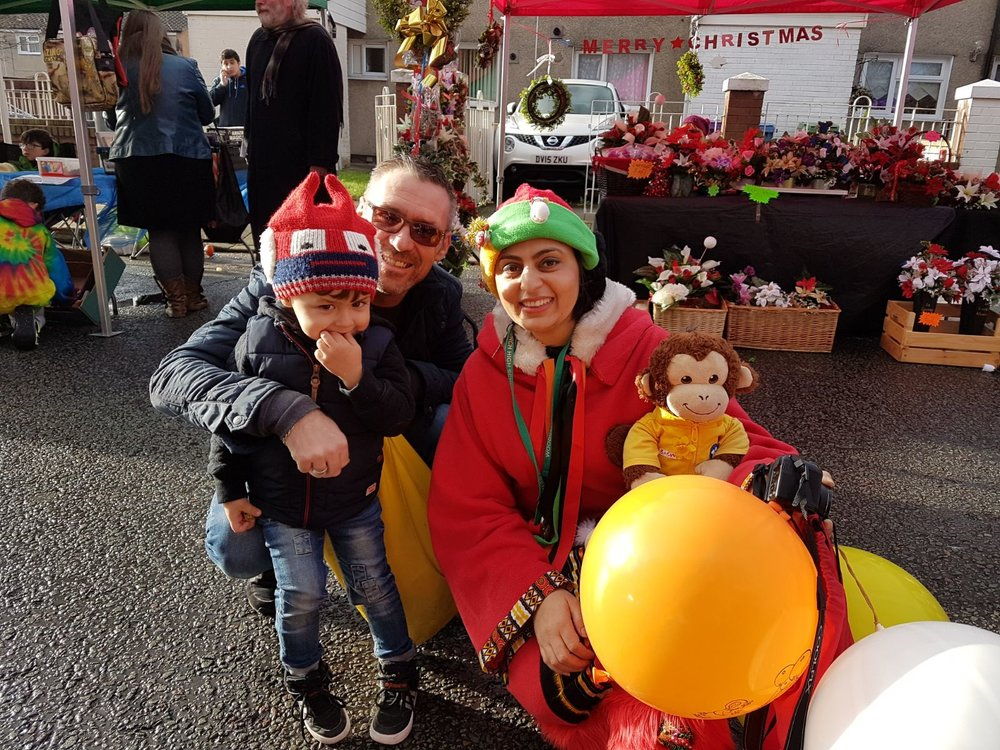 Mother Christmas with Christmas Market Visitors
