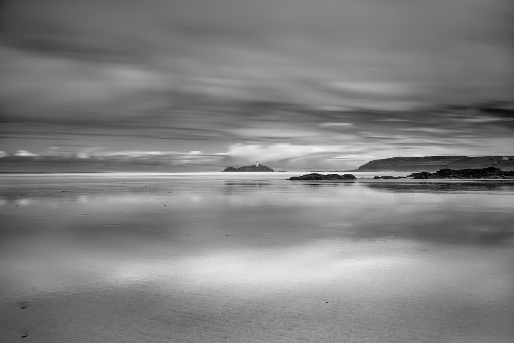 Godrevy Lighthouse from half way across St Ives Bay in monochrome