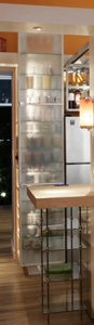 The kitchen's tall glassware cabinet can be admired from the living room.