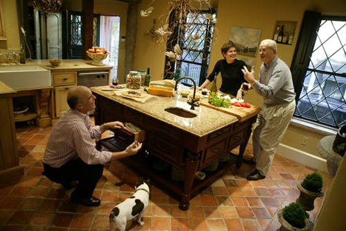 This candid photo captures the previous owners enjoying the moment in the kitchen they renovated with KRH's Paul Reidt. Photo by Nick Kelsh.