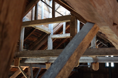 The barn's exposed beams looking to the cupola.