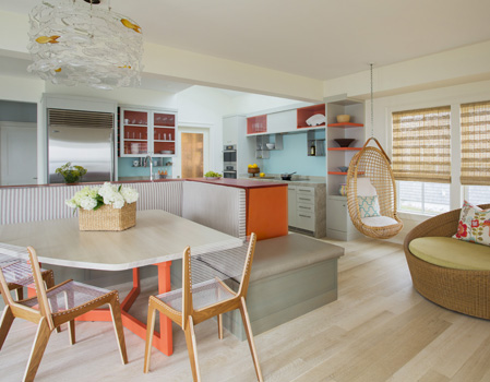 This photo taken by Eric Roth for Design New England shows the kitchen island's banquette. The table that comes out from the wall to add seating is not shown.