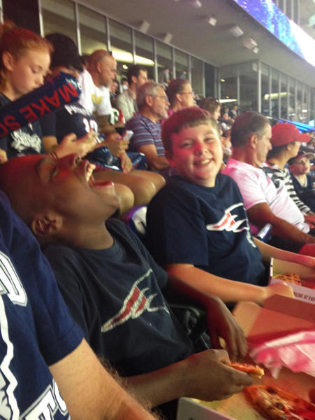Zaire and Andy's son, Alex, enjoying a game.