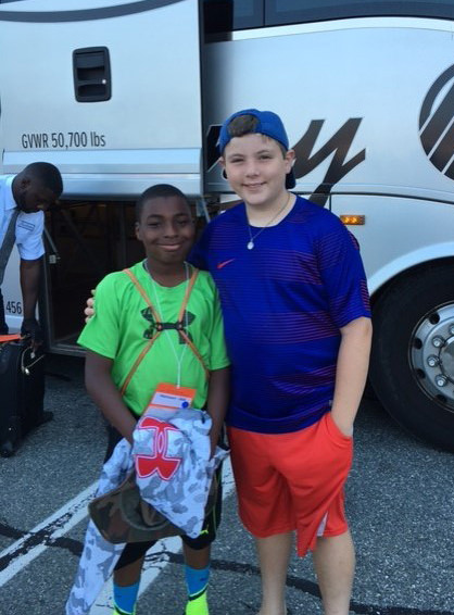 Zaire and Alex before Zaire boards the bus home...carrying lots of good memories.