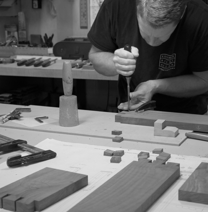Smitty working on hand-cut dovetails for pool cue racks. Expert chisel technique by a master craftsman!