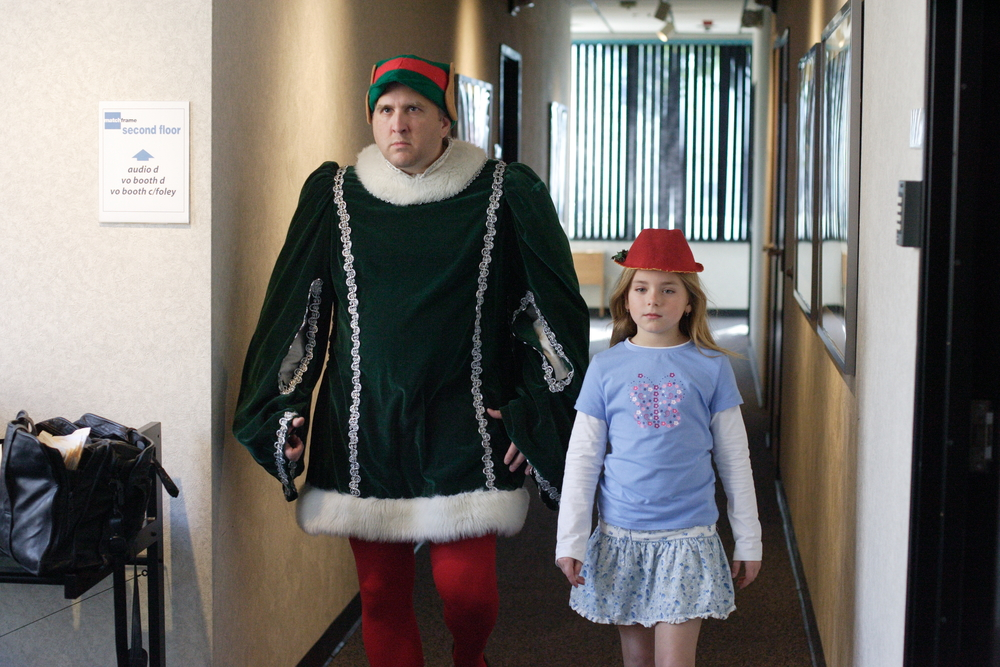 Daniel Roebuck method acting for his part as head elf, Paul Rocco. Daniel is pictured with Madison Davenport (Sophianna).
