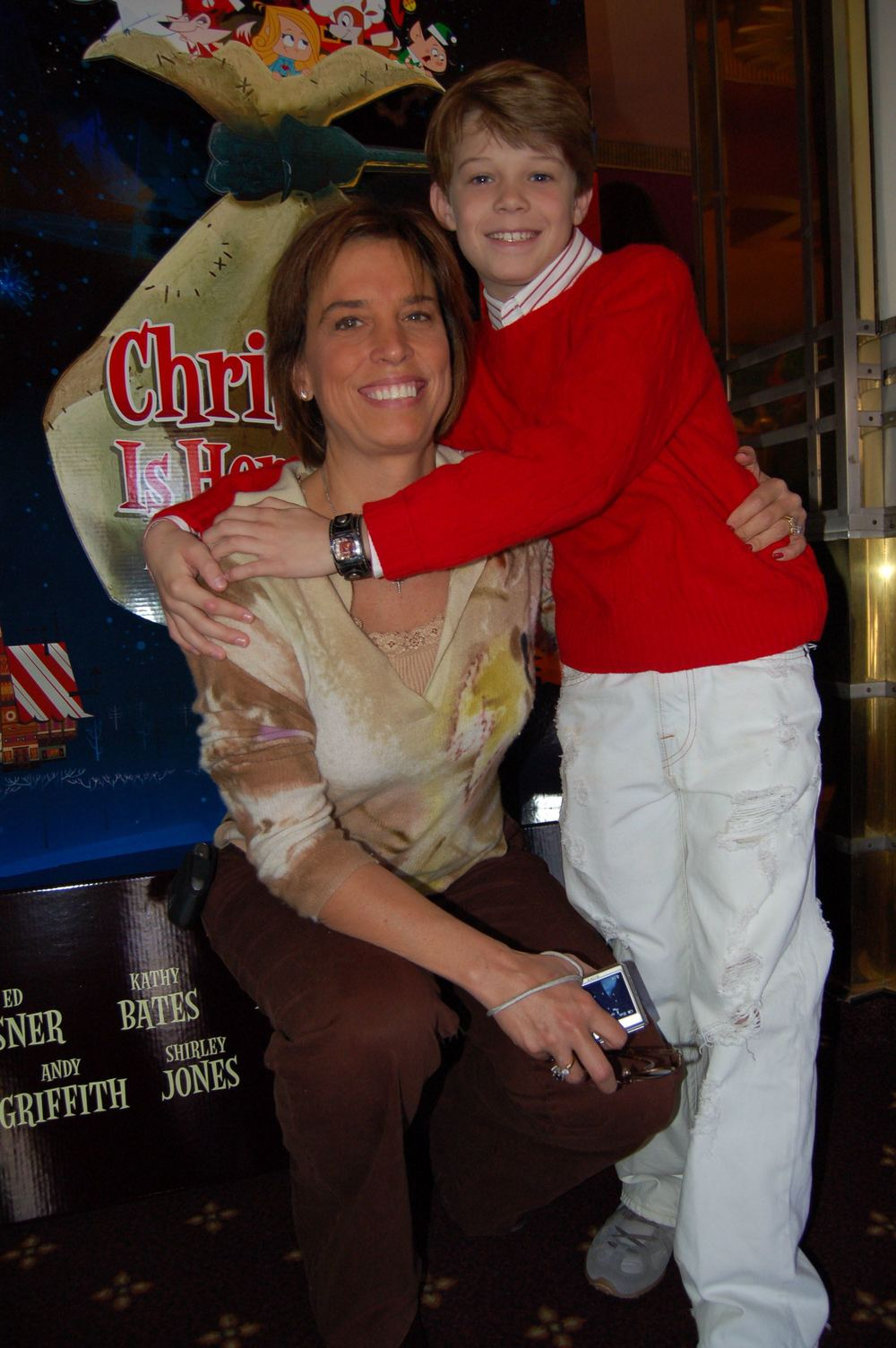 Colin Ford (Dart) hugs his mother at the Christmas is Here Again world premier in Los Angeles