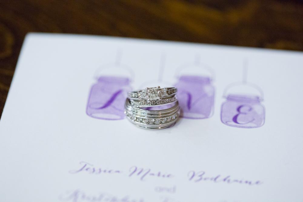 Wedding rings on wedding invitation wedding day details Minneapolis Minnesota photographer