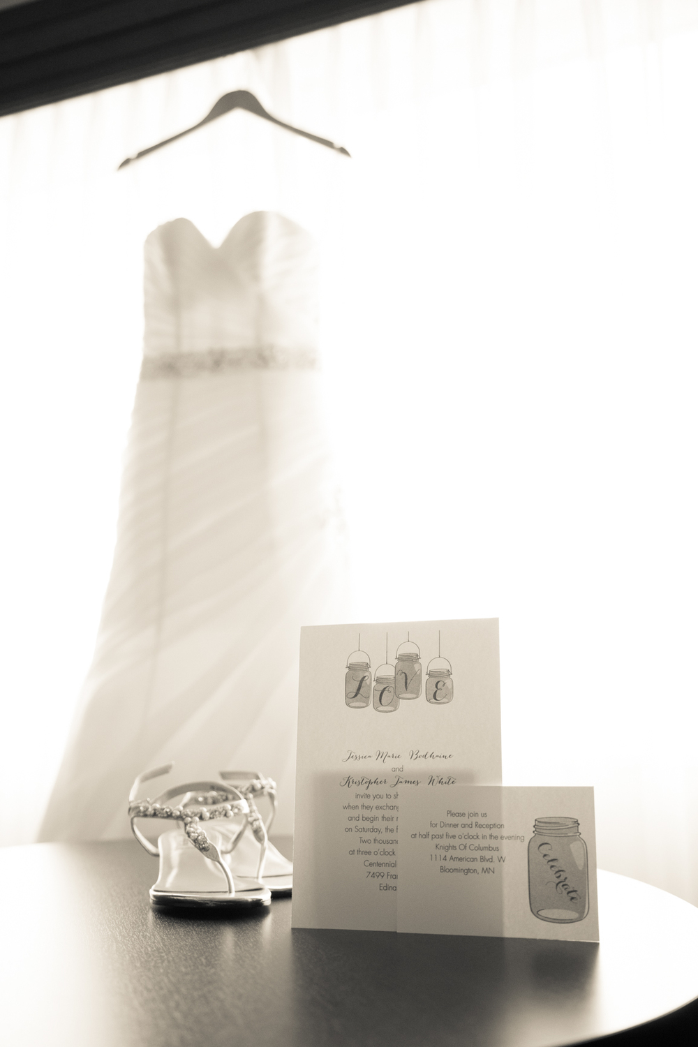 Wedding dress with wedding shoes and wedding invitation wedding day details Minneapolis Minnesota photographer