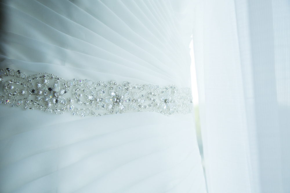Wedding dress hanging from window wedding day details Minneapolis Minnesota photographer
