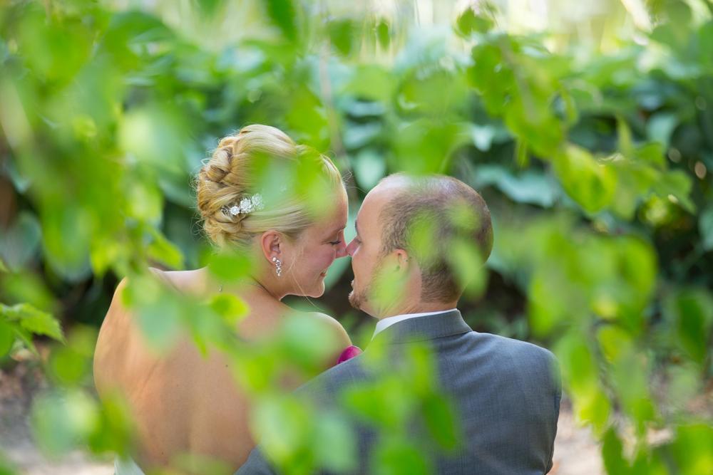 wedding bride and groom sweet kisses at Centennial Lakes Park Edina, Minnesota Wedding photographer
