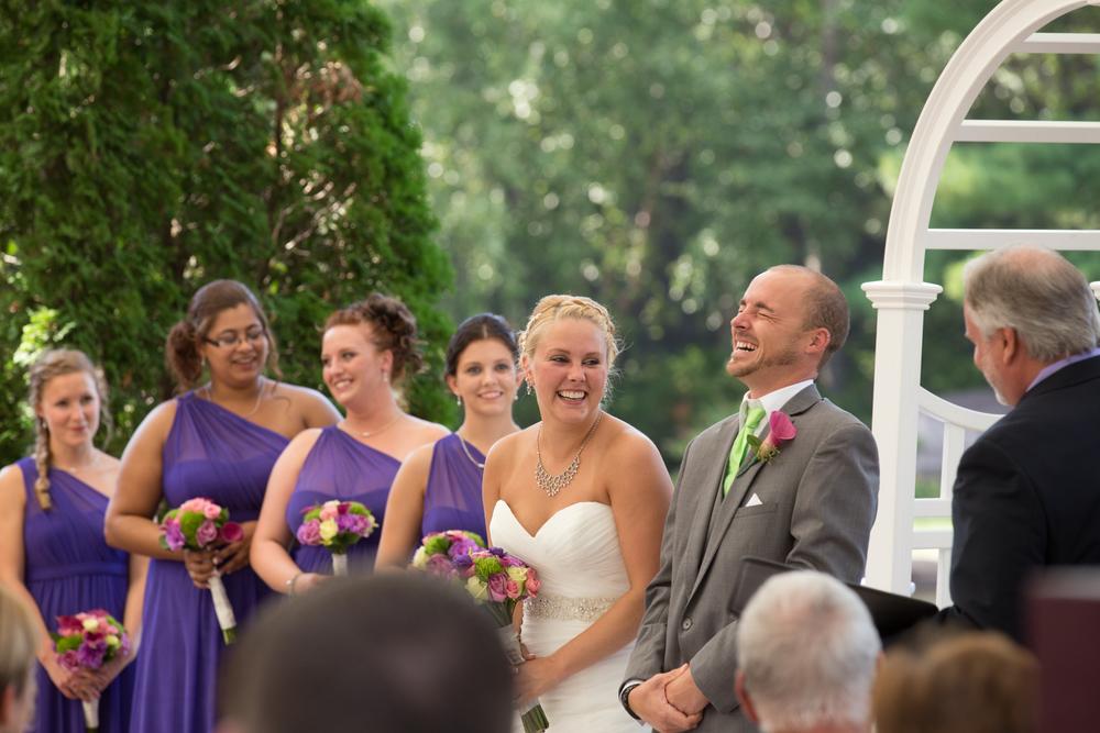 wedding bride and groom laughing at Centennial Lakes Park Edina, Minnesota Wedding photographer