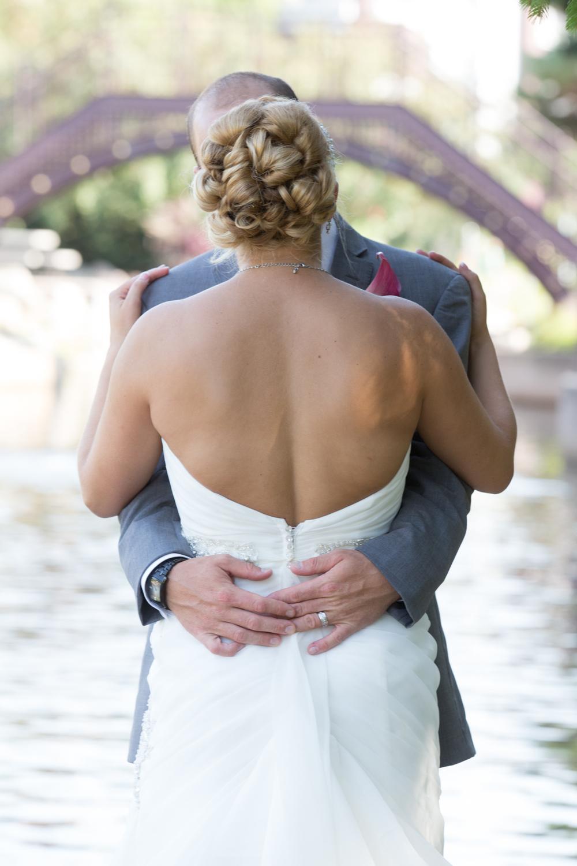 wedding bride and groom kissing at Centennial Lakes Park Edina, Minnesota Wedding photographer