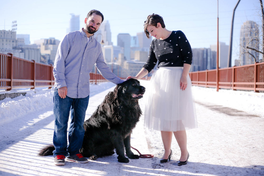 Engagement couple on the stone arch bridge with newfie