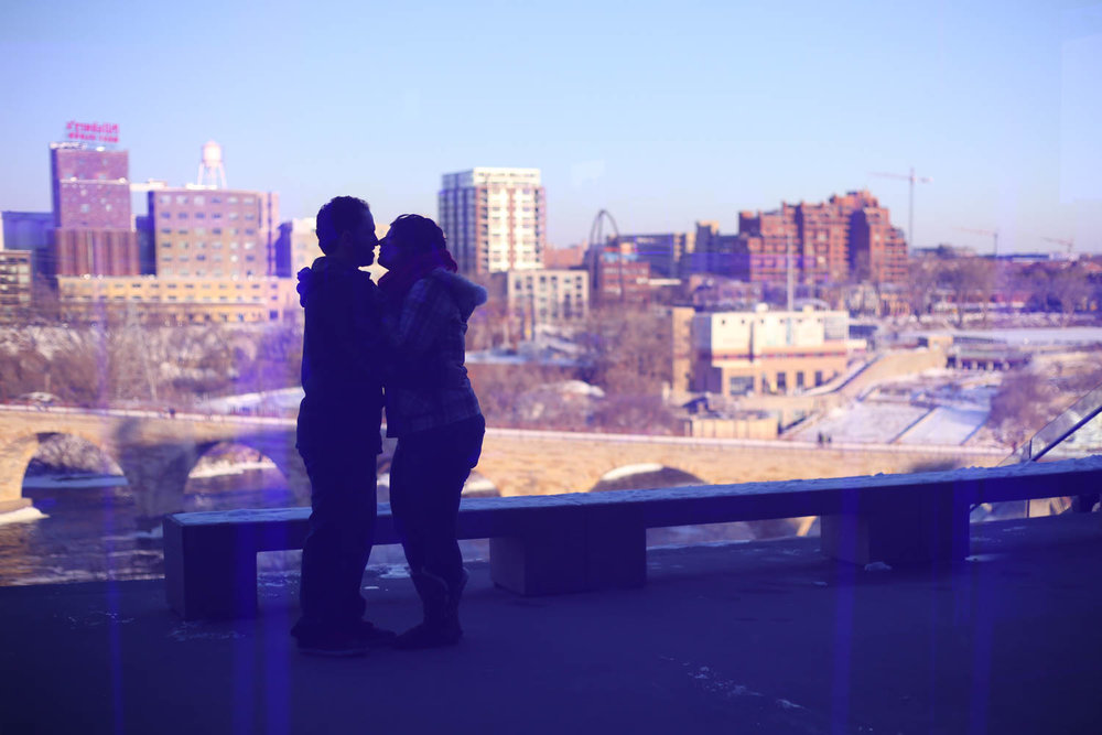 Engagement couple standing at the Guthrie Theater