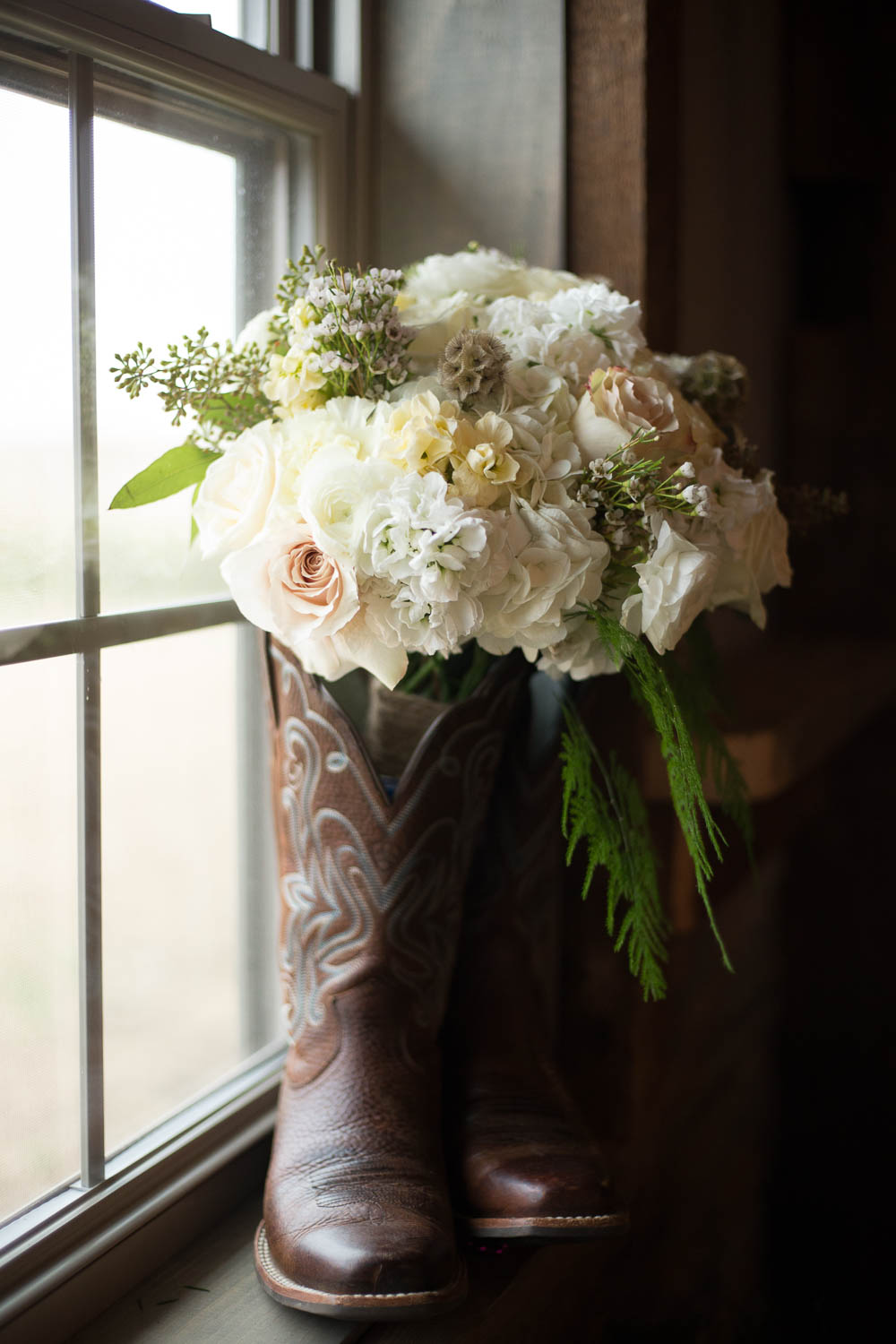 Wedding bouquet and boot at country wedding pedretti's party barn