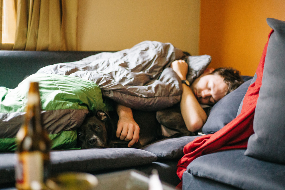 Bali the dog snuggles up to Loren Shumaker as he tries to wake up in Michigan, Sunday, April 10, 2016. Many thanks to Tori and Aaron for hosting us that evening.
