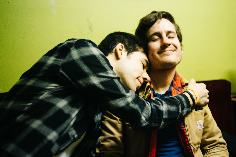 Max Stern hugs Ryan Ford of The Gunshy at Beat Kitchen, in Chicago, Illinois, Sunday, April 10, 2016.