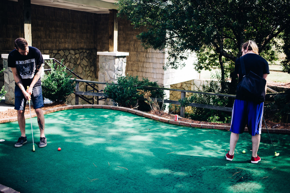Steve and Josh warm up at The Lost Duffer Miniature Golf Course in Charlotte, North Carolina.