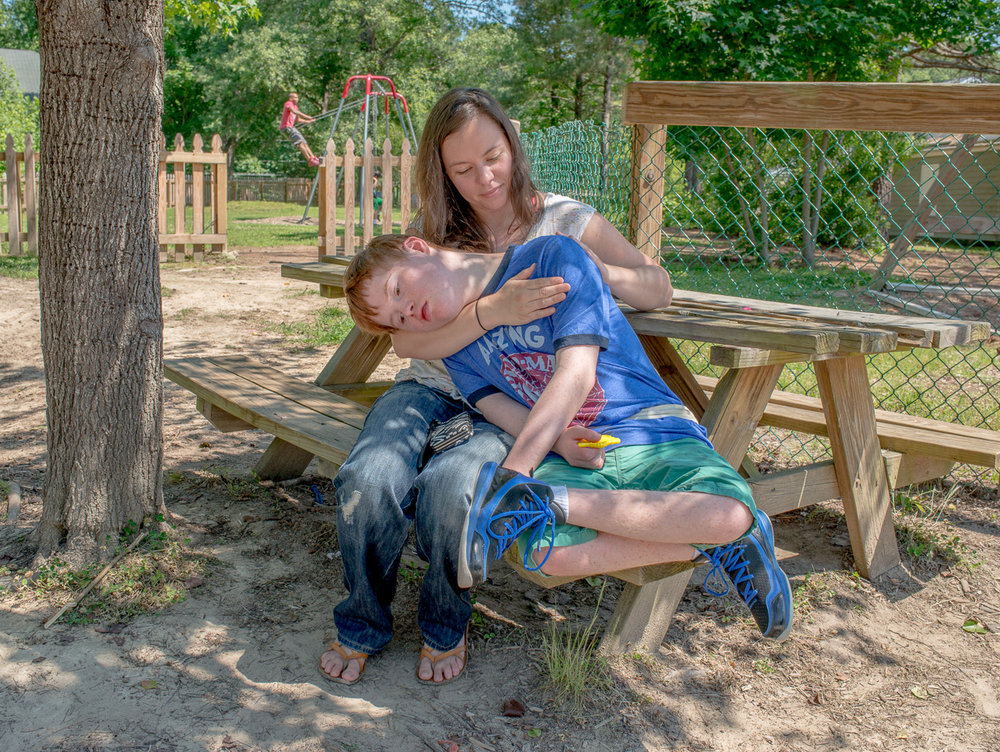 Joshua with his caregiver Sarah